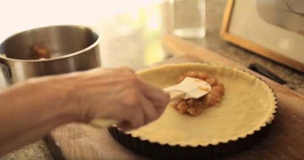 Spreading Apple Compote into a tart shell